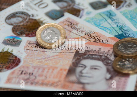 New UK currency, 10 pounds, 5 ponds, 1 pound coins - Stock Image