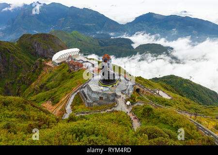 Sapa, Vietnam - October 08, 2018: A view to the Big Buddha statue and the cable car from the summit of the Fansipan Mountain on October 8, 2018, in Sa - Stock Image