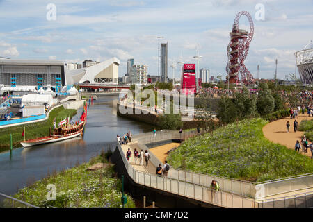 View south along River Lea with Royal Barge, Arenas and Orbit on a sunny day at Olympic Park, London 2012 Olympic - Stock Image