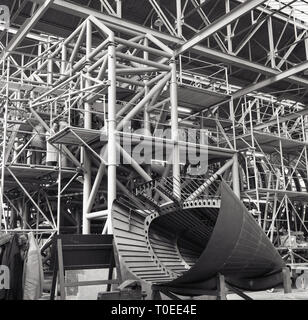 1950s, aircraft construction inside a large hangar, England, UK, showing the complicated platform structure necessary to build planes, - Stock Image