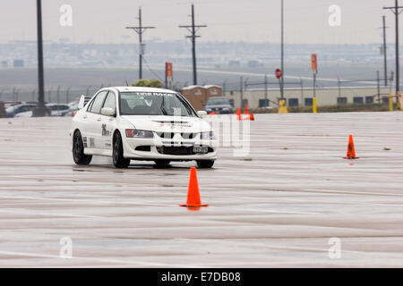 A white 2003 Mitsubishi Lancer Evolution Viii in an autocross race at a regional Sports Car Club of America (SCCA) - Stock Image