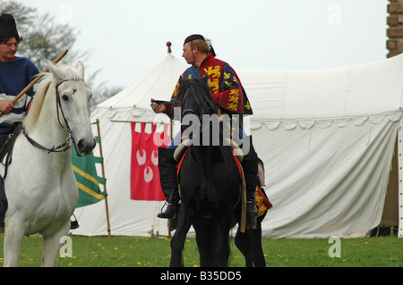 Squires on horseback at re-enactment - Stock Image