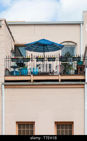 JONESBOROUGH, TN, USA-4/28/19: A balcony sets on the the second story of a commercial building. - Stock Image