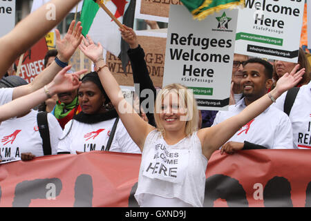 LONDON, UK - September 17: ​Entertained seen ahead of the march by thousands of people march through London to show - Stock Image