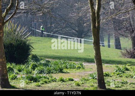 Leeds, UK – 29 March 2019.  Police remain on the scene at Potternewton Park in Leeds, where a 16-year-old was found with a serious stab wounds yesterday evening. A 17-year-old male was also taken to hospital after being found nearby with a serious head injury.  West Yorkshire Police say they believe there was a fight between two groups of youths and the two people in hospital have been arrested on suspicion of assault causing grievous bodily harm. Credit: James Copeland/Alamy Live News - Stock Image