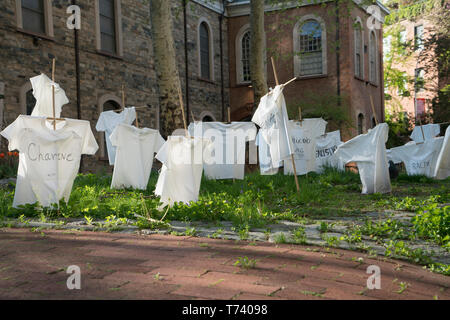 The East Yard of St. Mark's Church in-the-Bowery contains 98 crosses draped with T-shirts in memory of some of the New Yorkers killed by guns in 2018. - Stock Image
