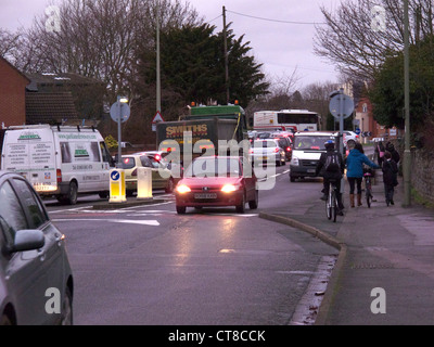 Morning commuter traffic on road in small market town of Abingdon, Oxfordshire. January 2011 - Stock Image