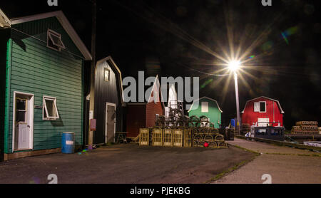 Building, boats and harbour at French River, Prince Edward Island. - Stock Image