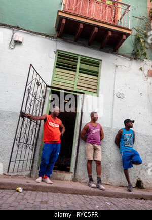 Hanging out in Havana, Cuba: men in a back street of the capital - Stock Image