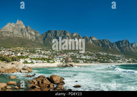 Camps Bay beach and the Twelve Apostles mountain range in Cape Town, South Africa. - Stock Image