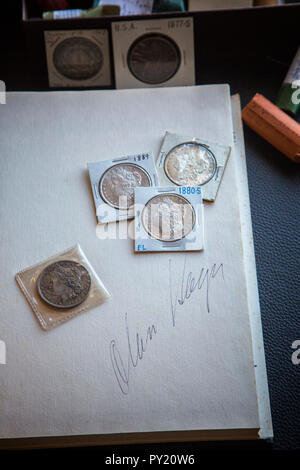 The Accugrade System reference book open to show signature of Alan Hager considered the first to offer a system for grading Mint State Morgan Dollars - Stock Image