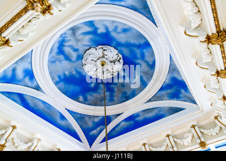 Clouds and blue sky painted on the ceiling of an ornate country house, stately home. - Stock Image