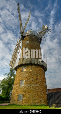 A burst of transient afternoon light bathes the stonework of Whissendine Windmill in Rutland. - Stock Image