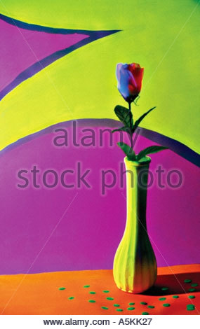 A silk rose in front of a painted background lit with black light 1995 - Stock Image
