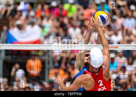 Ostrava, Czech Republic. 02nd June, 2019. L-R Ondrej Perusic (Czech) and Grzegorz Fijalka (Poland) in action during the four-star J&T Banka Ostrava Beach Open 2019, part of the FIVB Beach Volleyball World Tour, in Ostrava, Czech Republic, on July 2, 2019. Credit: Vladimir Prycek/CTK Photo/Alamy Live News - Stock Image