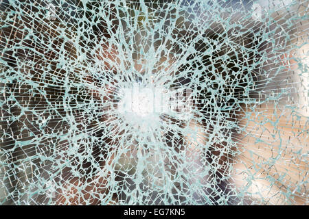 Picture of a window that has been vandalized - Stock Image