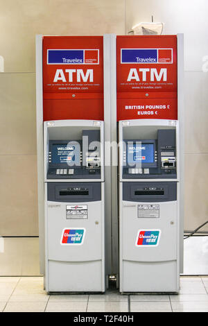 New York, 3/17/2019: Two Travelex currency exchange ATMs stand at JFK airport. - Stock Image