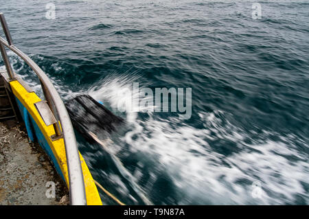 Pot being returned to the sea bed. (sequence 3/3). - Stock Image
