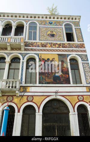 Mosiac on building on fine building in Grand Canal,Venice, Italy - Stock Image