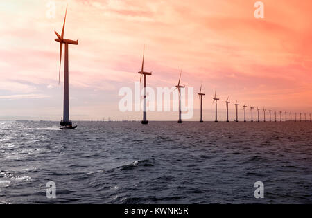 Middelgrunden Offshore Wind Farm outside Copenhagen Harbour. The Øresund Bridge to Sweden in the distance, - Stock Image