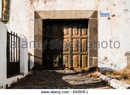 Ornate doorway of old building in Plaza de San Pedro, Vilaflor, Tenerife, Canary Islands, Spain - Stock Image