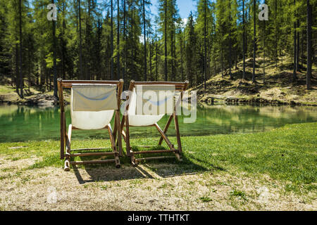 Two sun chairs in Lago Ghedina, an alpine lake in Cortina D'Ampezzo, Dolomites, Italy - Stock Image