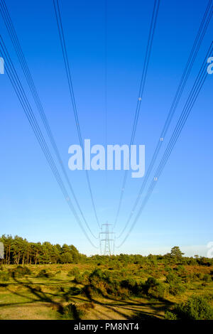 A transmission tower or power tower is a tall structure, usually a steel lattice tower, used to support an overhead power line. They are used in high- - Stock Image