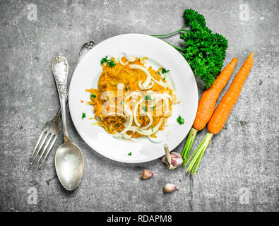 Carrot salad with spices. On rustic background. - Stock Image