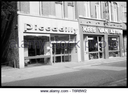 Tilburg, Netherlands. Fast Food Shop and Bike Store Facades inside a down towns treet, 1997. Since then both shops are closed and replaced by new, com - Stock Image