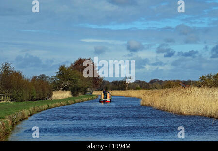 Cw 6674 Boating in West Lancashire 24.3.19  A narrow boat travels along the Leeds and Liverpool canal near Halsall in West Lancashire. - Stock Image