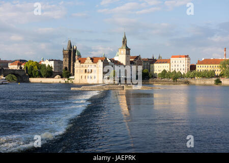 A weir in the River Vltava in Prague next to Charles Bridge, that is used to help regulate the river's flow - Stock Image