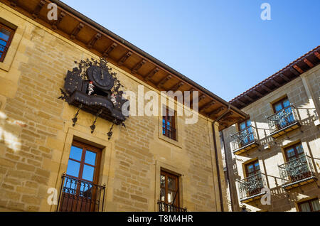 Laguardia, Álava province, Basque Country, Spain : Chiming clock with automata on the facade of the  townhall at Plaza Mayor square in the historic to - Stock Image