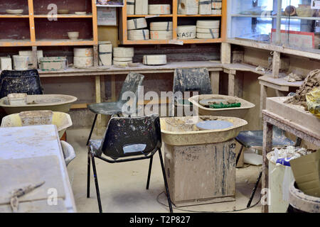 Pottery throwing wheels in craft workshop - Stock Image
