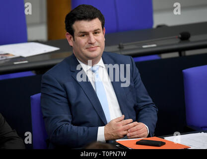 Berlin, Germany. 21st Mar, 2019. Hubertus Heil (SPD), Federal Minister of Labour and Social Affairs, sits at the Riegierungsbank at the 89th session of the Bundestag on 'Education and Participation for Children'. Credit: Britta Pedersen/dpa-Zentralbild/dpa/Alamy Live News - Stock Image