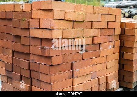 new red bricks stackedinteresting - Stock Image