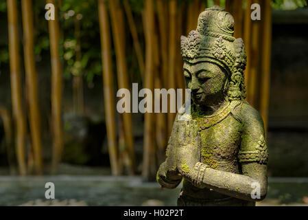 Stone statue in buddhist temple Mendut in Yogyakarta, Indonesia - Stock Image
