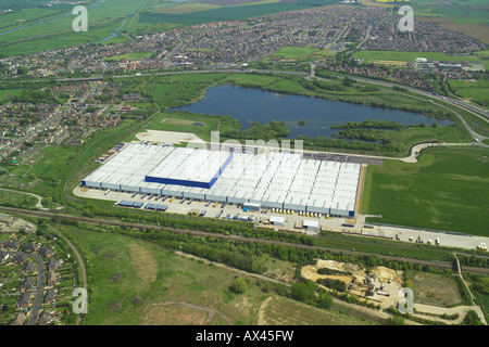 Aerial view of an out of town warehouse and distribution centre near Peterborough in Cambridgeshire - Stock Image