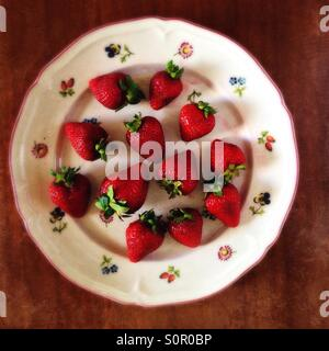 Strawberries on a floral plate - Stock Image