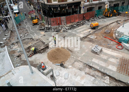 View of ROADWORKS enhancement project on Chiswell, Whitecross & Silk Streets Barbican Area London UK  KATHY - Stock Image