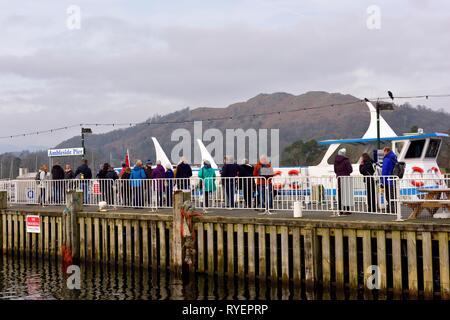 Ambleside passengers boarding a lake cruise,Lake Windermere,Lake District,Cumbria,England,UK - Stock Image