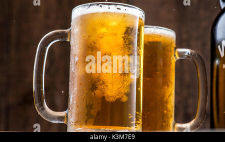 cold beer on mugs - Stock Image
