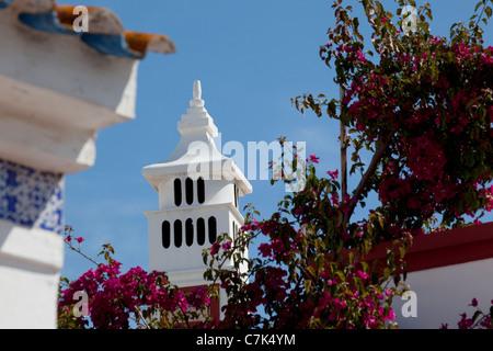 Portugal, Algarve, Alte, Flowers & Chimney - Stock Image