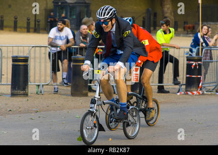 Cyclists racing on Horse Guards Road, Brompton World Championships 2018, London, UK - Stock Image