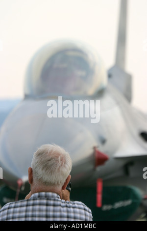 Viper targeted -senior man takes a photo of American fighter F 16 Fighting Falcon - Stock Image