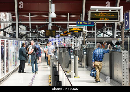 Male passenger waiting for a train at Paddington Station, London, UK - Stock Image