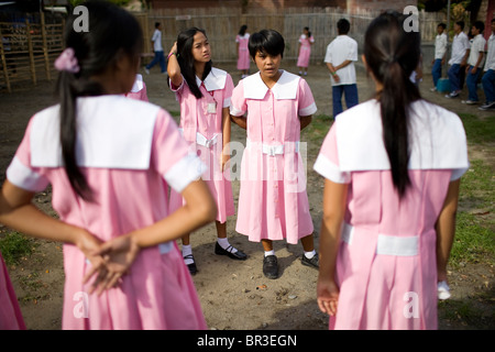Students line up for inspection at Penaverde Montessori School for inspection in Mansalay, Oriental Mindoro, Philippines. - Stock Image