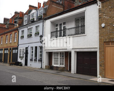 Mews houses in a road in Chelsea, London. UK. - Stock Image