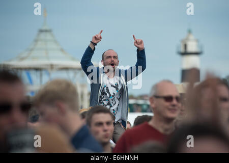 Southsea, UK. 24th Aug, 2014. Victorious Festival - Sunday, Southsea, Hampshire, England. A Kassassin Street fan - Stock Image