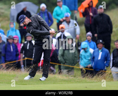 Portrush, County Antrim, Northern Ireland. 17th July 2019. The 148th Open Golf Championship, Royal Portrush Golf Club, Practice day ; Justin Rose (ENG) hits a short iron to the green on the par four 14th hole Credit: Action Plus Sports Images/Alamy Live News - Stock Image
