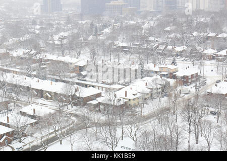 Toronto midtown residential city blocks in snowfall in winter - Stock Image
